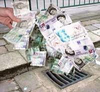 money going down a drain