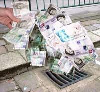 money going down a drain